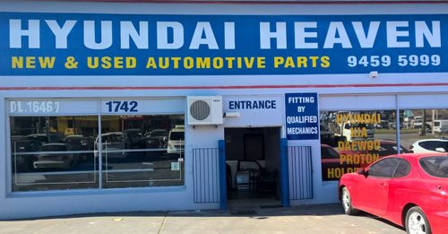 Front view of banner of the Hyundai Heaven showroom in Perth with their contact number
