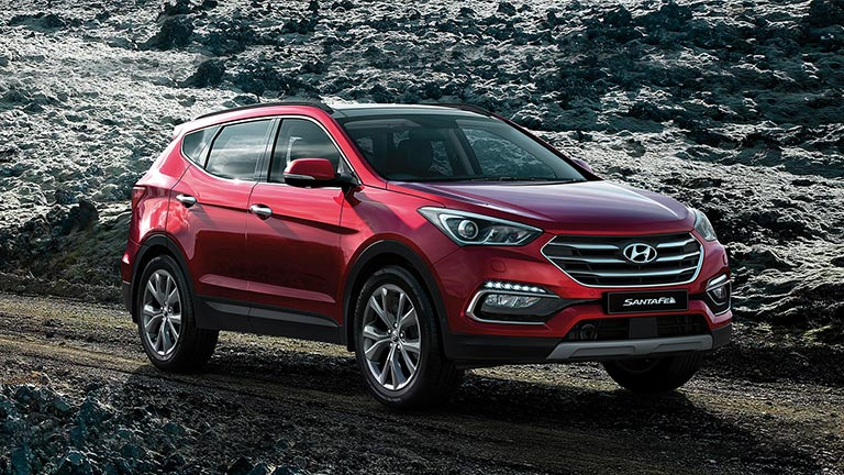 Red Hyundai Santa FE DM on a rocky terrain
