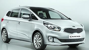 The Kia Carens with 10 spoke alloy wheels and a body colored sun roof