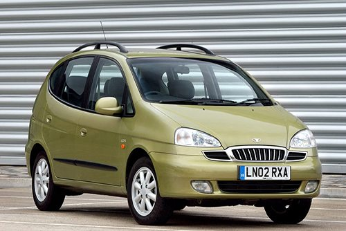 Light military green Daewoo Tacuma U100 pictured outside a garage