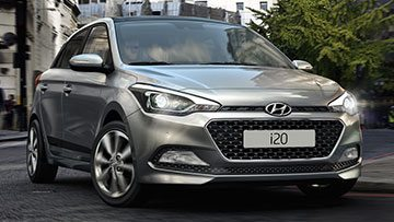 Shiny metallic grey Hyundai i20 with all new grille and black strips along the doors