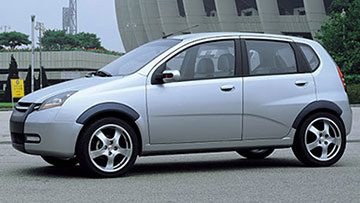 Side view of the hatchback Daewoo Kalos T200 in grey color on the showroom floor