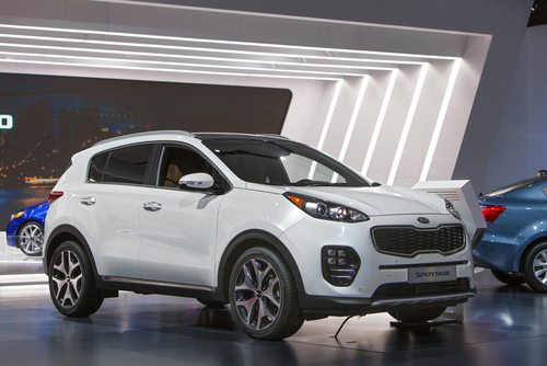 Kia Sportage, the sports hatchback with wider rims and tyres parked at the Kia auto show