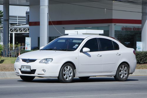 White Proton Persona sedan pictured outside the gas station