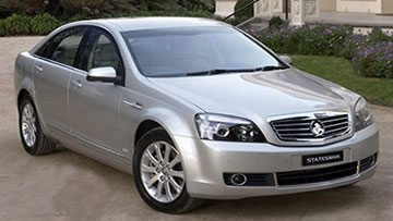 Cropped image of a silver Holden Statesman Caprice pictured outside a Villa