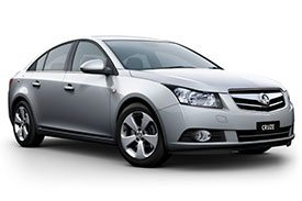 Light grey Holden Cruze with blue tinted windows and beautiful five spoke rims