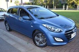 A second series of the top selling GDe3 model, blue Hyundai i30 parked outside a garden