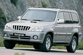 A huge SUV in all its might, the Hyundai Terracan pictured on a hilly road