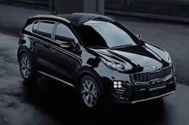 Latest model of the Kia sportage line of sports cum SUV cars in all-metallic black paint