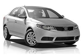 Front angled view of Kia Cerato TD sedan with a stylish bumper & non-tinted window glasses