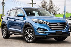 A second generation of the Hyundai Tucson TL, covered with shiny metallic blue and new chrome rims