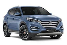 All-blue Hyundai Tucson TL with sporty black rims and all new front bumper