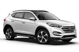 Side view of a white Hyundai Tucson TLE2 mini SUV