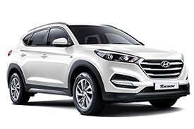 The TLe model numbered all-white Hyundai Tucson mini SUV with lightly tinted window panes