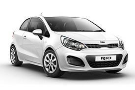 A white and sporty Kia Rio hatchback with two doors and lightly tinted window panes