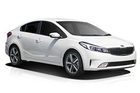 The all new Kia Cerato YD sedan in royal white and light black tinted glasses