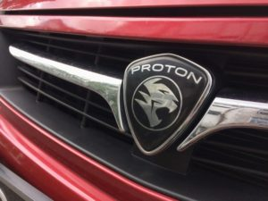 Proton badge on the front of a car